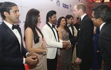 Britain's Prince William shakes hands with Bollywood actor Shah Rukh Khan at reception at Taj hotel in Mumbai, India, on April 10, 2016. (REUTERS/Rafiq Maqbool/Pool)