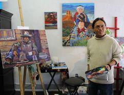 Navajo artist Bahe Whitethorne, Jr. describes Flagstaff's lively art scene while painting at a cooperative downtown studio. Flagstaff, Arizona (Barbara Taylor London Free Press/Postmedia News)