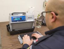Const. Phil Gavin at the Niagara Regional Police detachment in St. Catharines with an Intoxilyzer 8000C breathalyzer February 18 2016. (Bob Tymczyszyn/Postmedia Network)