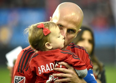 May 7, 2016; Toronto, Ontario, CAN;  Toronto FC midfielder Michael Bradley (4) kisses his daugther Quinn Elle before kickoff against FC Dallas at BMO Field. Mandatory Credit: Dan Hamilton-USA TODAY Sports