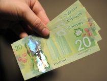 Canadian $20 bills currency money GETTY