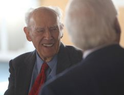 George Muirhead talks to former Kingston mayor and MPP John Gerretsen. (Elliot Ferguson/The Whig-Standard)