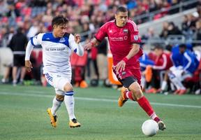 Edmonton's Dustin Corea (left) chases down Fury FC's Onua Thomas Obasi during the first half on May 18 at TD Place. (Wayne Cuddington, Postmedia Network)