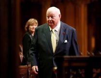 Senator Mike Duffy walks in the Senate chamber on Parliament Hill in Ottawa on May 3, 2016. REUTERS/Chris Wattie