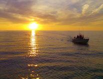 Fishing during a Lake Huron sunset. (Troy Patterson/Kincardine News)