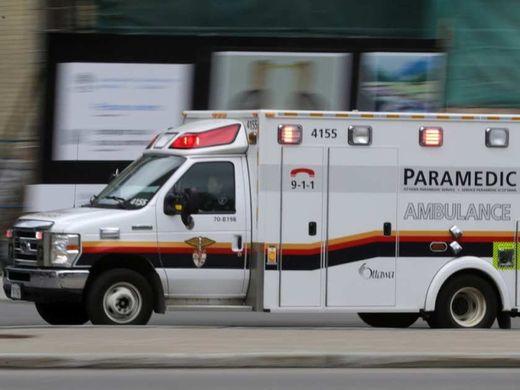 Man suffers broken legs when struck by car while mowing lawn