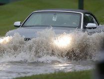 Heavy rain floods a street in Winnipeg in this August 22, 2015 file photo. (Postmedia Network)
