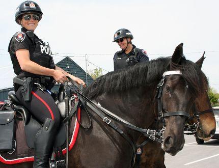 Kingston Police Const. Sarah Groenewegen on Donovon in Kingston, Ont. on Saturday May 21, 2016. Steph Crosier/Kingston Whig-Standard/Postmedia Network