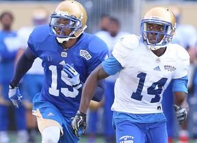 Winnipeg Blue Bombers wide receiver Quincy McDuffie (r) runs a pattern with defensive back Jonte Green during CFL football practice in Winnipeg, Man. Monday May 30, 2016. BRIAN DONOGH/Winnipeg Sun