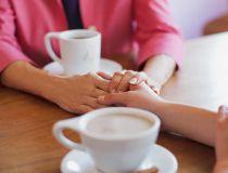 hands friends women getty