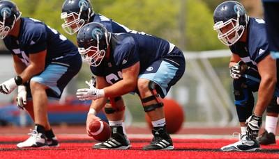 Toronto Argonauts Sean McEwen OL (61) snaps the ball  during practice in Guelph, Ont. on Thursday June 2, 2016. Jack Boland/Toronto Sun/Postmedia Network
