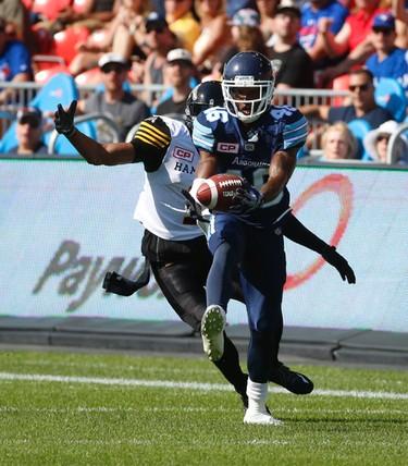 Toronto Argonauts TJ Heath DB (46) picks off a ball intended for Hamilton Tiger-Cats Tiquan Underwood WR (1) during the second quarter pre-season game at BMO Field  Toronto, Ont. on Saturday June 11, 2016. Jack Boland/Toronto Sun/Postmedia Network
