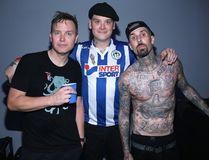 (L-R) Musicians Mark Hoppus, Matt Skiba and Travis Barker of Blink-182 backstage as Bethesda Softworks Jonathan Leibson/Getty Images for Bethesda Softworks LLC/AFP