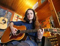 <p>Jennifer Holub rehearses at Cosmic Dave's Guitar Emporium in Sudbury. Gino Donato/Sudbury Star/Postmedia Network
