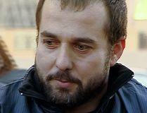 In this framegrab taken from Rustavi2 footage dated 2012, Akhmed Chatayev speaks to the media in Tbilisi, Georgia. (Georgian broadcasting company Rustavi2, AP video via AP)
