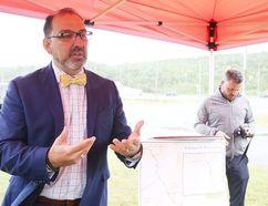 Sudbury MPP Glenn Thibeault tells media Friday that programs are available to help Northerners with high hydro bills. (Gino Donato/Sudbury Star)