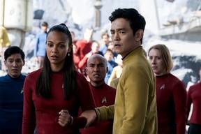 "Zoe Saldana, left, as Uhura and John Cho as Sulu appear in a scene from, ""Star Trek Beyond."""