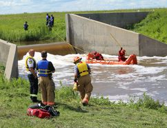 Crews search the area where Travis Bauman was last seen. (Cassidy Dankochik/The Winkler Times)