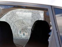 A car hit by gunfire sits outside of Club Blu
