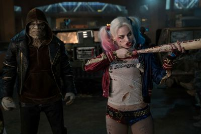 Adewale Akinnuoye-Agbaje as Killer Croc and Margot Robbie as Harley Quinn in Suicide Squad. (Courtesy of Warner Bros.)