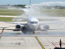 A New Leaf jet is sprayed with water as it arrives in Winnipeg, Man. Monday July 25, 2016. Brian Donogh/Winnipeg Sun/Postmedia Network