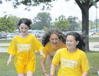 Carl Hnatyshyn/Postmedia Network Temple Baptist Church Day campers Elysa Blevins, 10, Serena Wygergangs, 9, and Kendra Hummel, 11, dive headfirst onto the camp's slip 'n' slide.