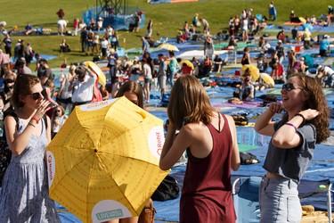 Attendees find each other during the Edmonton Folk Music Festival at Gallagher Park in Edmonton, Alberta on Thursday, August 4, 2016. Ian Kucerak / Postmedia