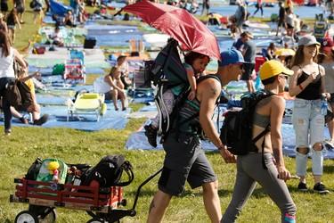 Attendees arrive for the Edmonton Folk Music Festival at Gallagher Park in Edmonton, Alberta on Thursday, August 4, 2016. Ian Kucerak / Postmedia