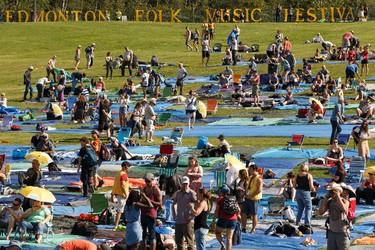 People setup their tarps during the Edmonton Folk Music Festival at Gallagher Park in Edmonton, Alberta on Thursday, August 4, 2016. Ian Kucerak / Postmedia