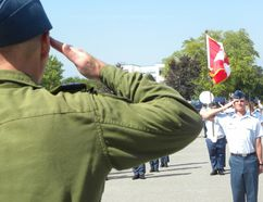 Ernst Kuglin/The Intelligencer Review Officer Lt. Col. Trevor Campbell salutes Parade Commander, cadet Patrick Dye, during Friday's general training graduation parade (Serial 2) at the Trenton Cadet Training Centre at CFB Trenton.