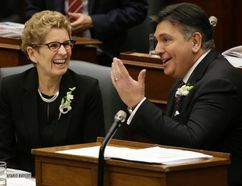 Ontario's Minister of Finance Charles Sousa and Premier Kathleen Wynne. (Craig Robertson/Toronto Sun)