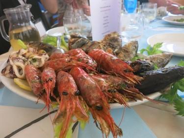 Grilled shellfish at Ittioturismo restaurant. (Rita DeMontis/Toronto SUN)