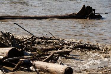Debris flows along the North Saskatchewan River near the Low Level Bridge as water levels rise in the river in Edmonton, Alberta on Wednesday, Aug. 24, 2016. Ian Kucerak / Postmedia