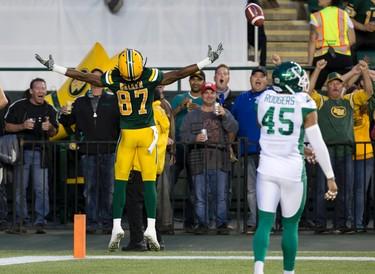 The Edmonton Eskimos' Derel Walker (87) celebrates a touchdown against the Saskatchewan Roughriders during first half CFL action at Commonwealth Stadium, in Edmonton on Friday Aug. 26, 2016. Photo by David Bloom