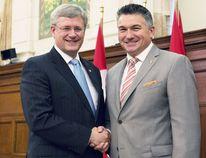Then Prime Minister Stephen Harper shaking hands with Selkirk-Interlake-Eastman MP James Bezan. (File photo)