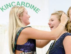 Outgoing Kincardine Fall Fair ambassador Hailey Allen places a tiara upon newly appointed Kincardine ambassador Delage Mowle. (Darryl Coote/Reporter)