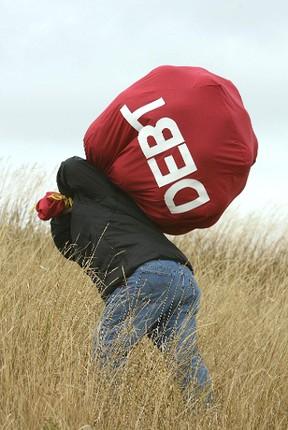 Man carries a debt bag. Postmedia Network