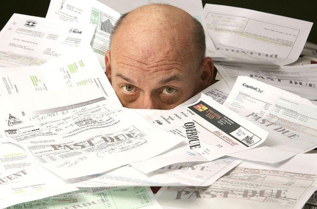 Drowning in debt Cornwall Standard-Freeholder/Postmedia Network