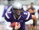 Western Mustangs quarterback Stevenson Bone runs with the ball. (Free Press file photo)