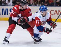 Team Canada centre Sidney Crosby (left) battles Team Czech Republic centre Vladimir Sobotka (right) during World Cup of Hockey action in Toronto on Saturday, Sept. 17, 2016. (Craig Robertson/Toronto Sun)