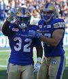 Winnipeg Blue Bombers RB Timothy Flanders (left) celebrates his touchdown run against the Toronto Argonauts on Saturday. (Kevin King/Winnipeg Sun photo)
