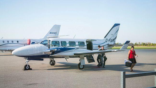 Visitors to Niagara disembark a plane at Niagara District Airport Monday September 19, 2016 . Bob Tymczyszyn/St. Catharines Standard/Postmedia Network