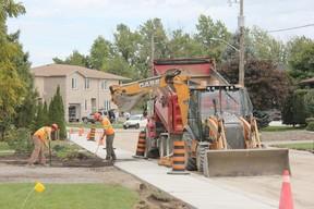 Municipal staff work on the installation of a new sidewalk on Moore Street. JONATHAN JUHA/ STRATHROY AGE DISPATCH/ POSTMEDIA NETWORK