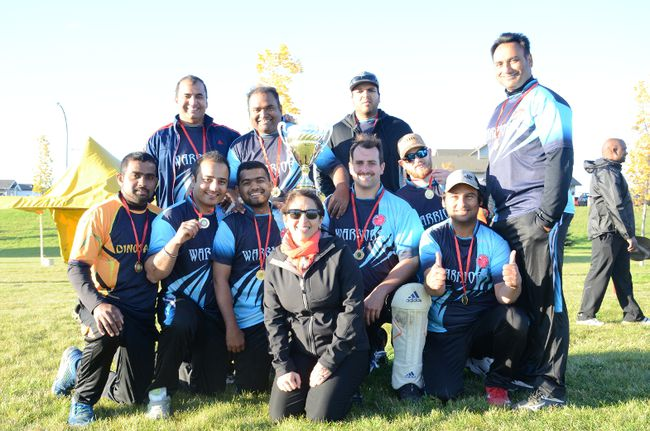 The Warriors took the Grande Prairie Cricket Association's Champions Trophy. The team includes (standing) Rajesh Sharma, Avinash Sinha, Sumit Bharadwaj, Tarlochan Minhas, Manoj Chamara (seated), Gurminder Singh, Trilok Patel, Dr. Inder Dhir, Jeremy Lane, Harry Addsett, Munzir Hassan.