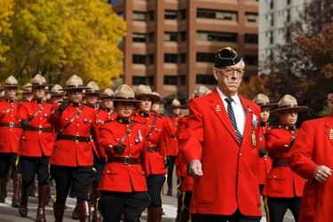 RCMP officers march during Alberta's Police and Peace Officers' Memorial Day at the Alberta Legislature in Edmonton, Alberta on Sunday, September 25, 2016. Ian Kucerak / Postmedia