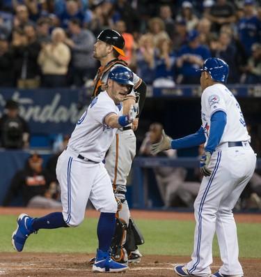 Toronto Blue Jay's celebrates his two run home run against the Baltimore Orioles in Toronto, Ont. on Tuesday September 27, 2016. Craig Robertson/Toronto Sun/Postmedia Network