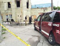Investigators at scene of fatal fire (Vicki Gough/Chatham Daily News)