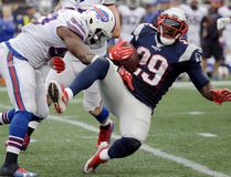 Bills linebacker Zach Brown (left) tackles Patriots running back LeGarrette Blount (29) during second half NFL action in Foxborough, Mass., on Sunday, Oct. 2, 2016. (Elise Amendola/AP Photo)