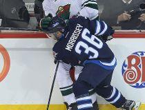 Winnipeg Jets defenceman Josh Morrissey (l) checks Minnesota Wild defenceman Marco Scandella during NHL hockey in Winnipeg, Man. Thursday September 29, 2016.