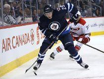 Winnipeg Jets forward Patrik Laine stick handles behind the Carolina Hurricanes goal during NHL action in Winnipeg on Thu., Oct. 13, 2016. Kevin King/Winnipeg Sun/Postmedia Network Kevin King, Kevin King/Winnipeg Sun
